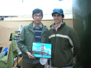 Spancer (left) buys a painting from me.